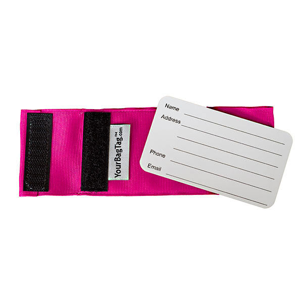 back of pink luggage tag showing address card insert