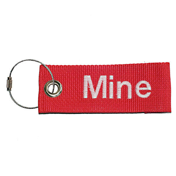 red extreme luggage tag with white text from YourBagTag