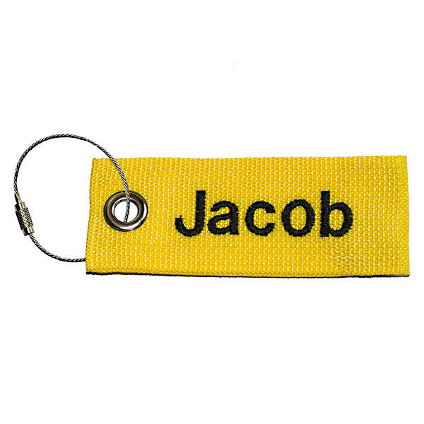 yellow extreme luggage tag with black text from YourBagTag