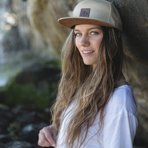 Hailey Cecie outdoors wearing the tan canvas Treefort Lifestyle Products Canopy Cap with secret stash pocket.