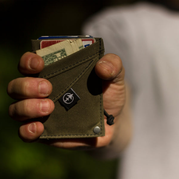 The Grip Wallet Green waxed canvas by Treefort Lifestyles