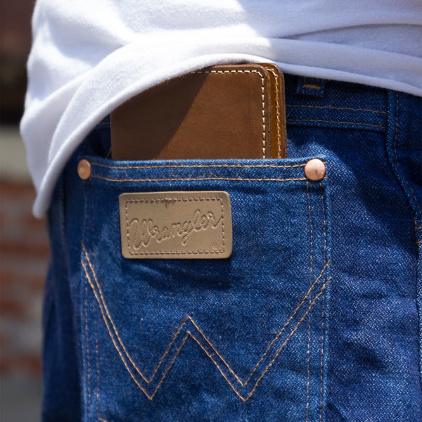 Handcrafted leather passbook denim pocket detail shot