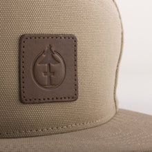 Load image into Gallery viewer, Leather de-bossed detail of the Treefort Lifestyles Canopy Cap in tan canvas, made in the USA.