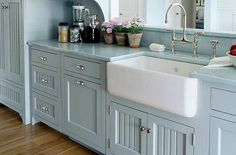 Blue farmhouse kitchen with farmhouse sink