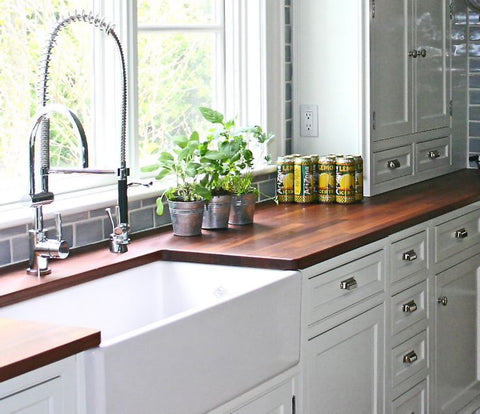 Butcher block countertop farmhouse kitchen with farmhouse sink