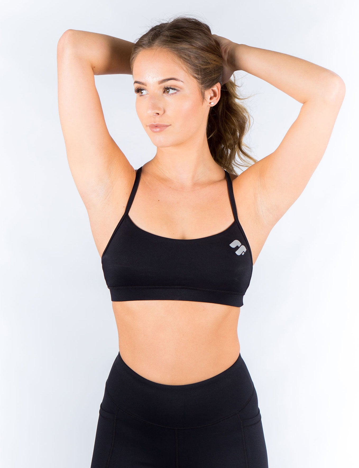 28d54153568be black sports bra front view ...