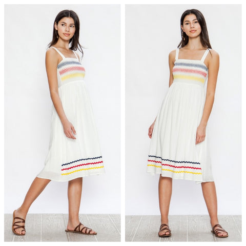 Summery white smocked sundress with colorful rickrack trim.