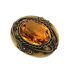 Exquisite true vintage 1930's amber Czech glass brooch in an ornate Etruscan revival setting.