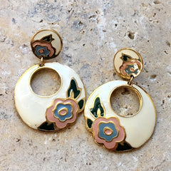 Painted enamel vintage hoop earrings with an art nouveau motif.