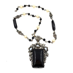 Elegant vintage 1920's art deco black glass pendant necklace with pearl beads.