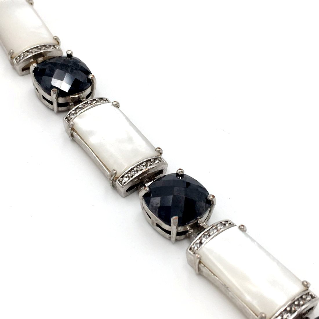Art-deco-style vintage 1950's mother of pearl rhinestone bracelet.