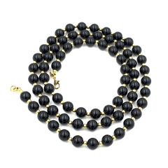 Classic vintage black and gold beaded Monet necklace.