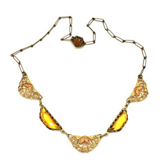 Lovely vintage 1930's art deco amber Czech glass necklace with hand-painted enamel leaves on filigreed links.