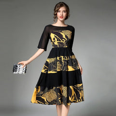 Stunning 1950's-inspired a-line dress with a black and yellow novelty print.