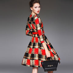 Classic red and camel plaid swing dress with matching red belt.