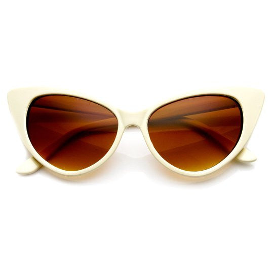 Iconic and sophisticated bisque cat-eye sunglasses with re-enforced metal hinges & polycarbonate UV protected lenses.