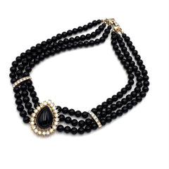 Classic vintage 1960's black triple-strand necklace with rhinestone accents.