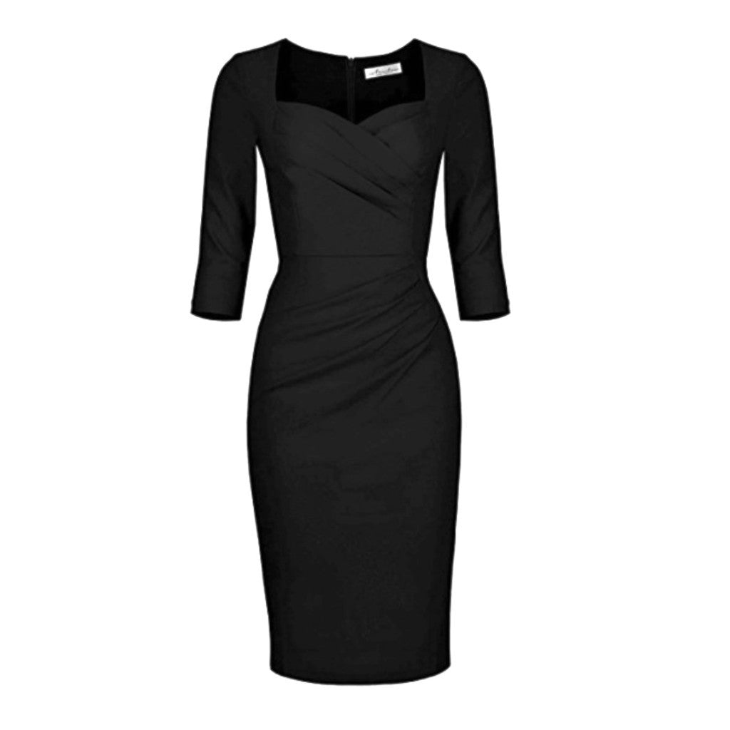 1950's-inspired hourglass black dress with sweetheart neckline and three-quarter-length sleeves.