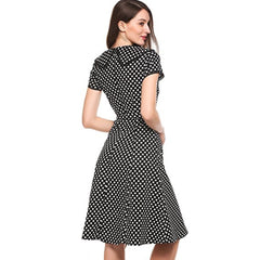Sophisticated black a-line tea dress in a classic polka dot print.