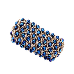 Intricately woven sapphire blue crystal statement cuff bracelet.