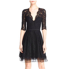 Black lace a-line dress with sleeves.