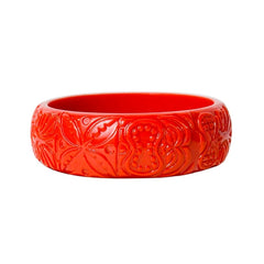 Fabulous 1960's-inspired carved red lucite bangle bracelet.