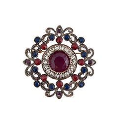 Ornate, vintage-inspired red, blue and clear rhinestone brooch.