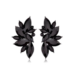 Elegant 1950's-style black teardrop pierced cluster earrings.