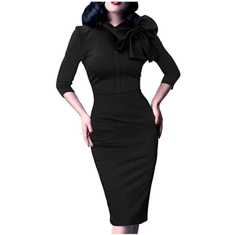 With its classic hourglass silhouette, this stunning black dress evokes the polished sophistication of 1940
