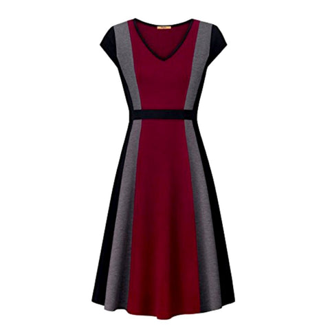 Sophisticated color block a-line dress with cap sleeves.