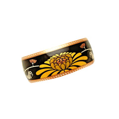 "Beautifully designed by Franklin Mint, this stunning vintage cuff bracelet is an homage to Japanese culture with its central chrysanthemum (""kiku"") theme."