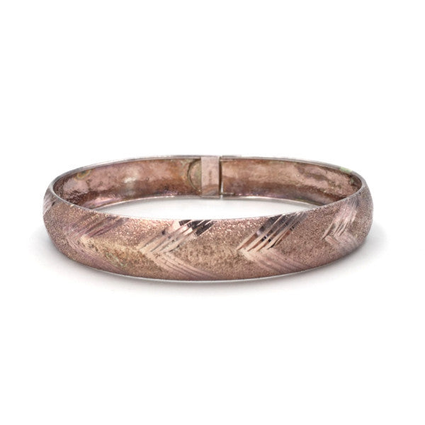 Vintage pink gold bangle bracelet with chevron etching.