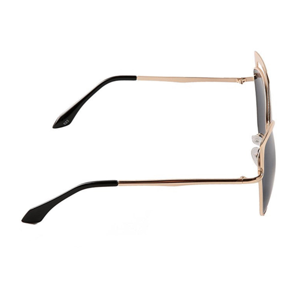 Chic, oversized cat-eye sunglasses with gold-tipped frames.