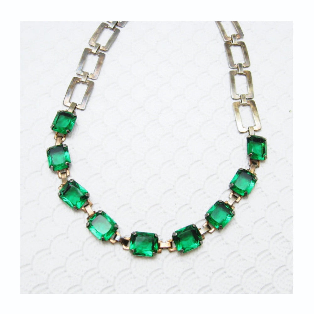 Exquisite 1920's deco sterling silver necklace with deep emerald green glass chiclet stones in open backed prong settings.