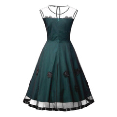 Show-stopping 1950s-style forest green party dress with a rosette trimmed sweetheart neckline and sheer illusion overlay.
