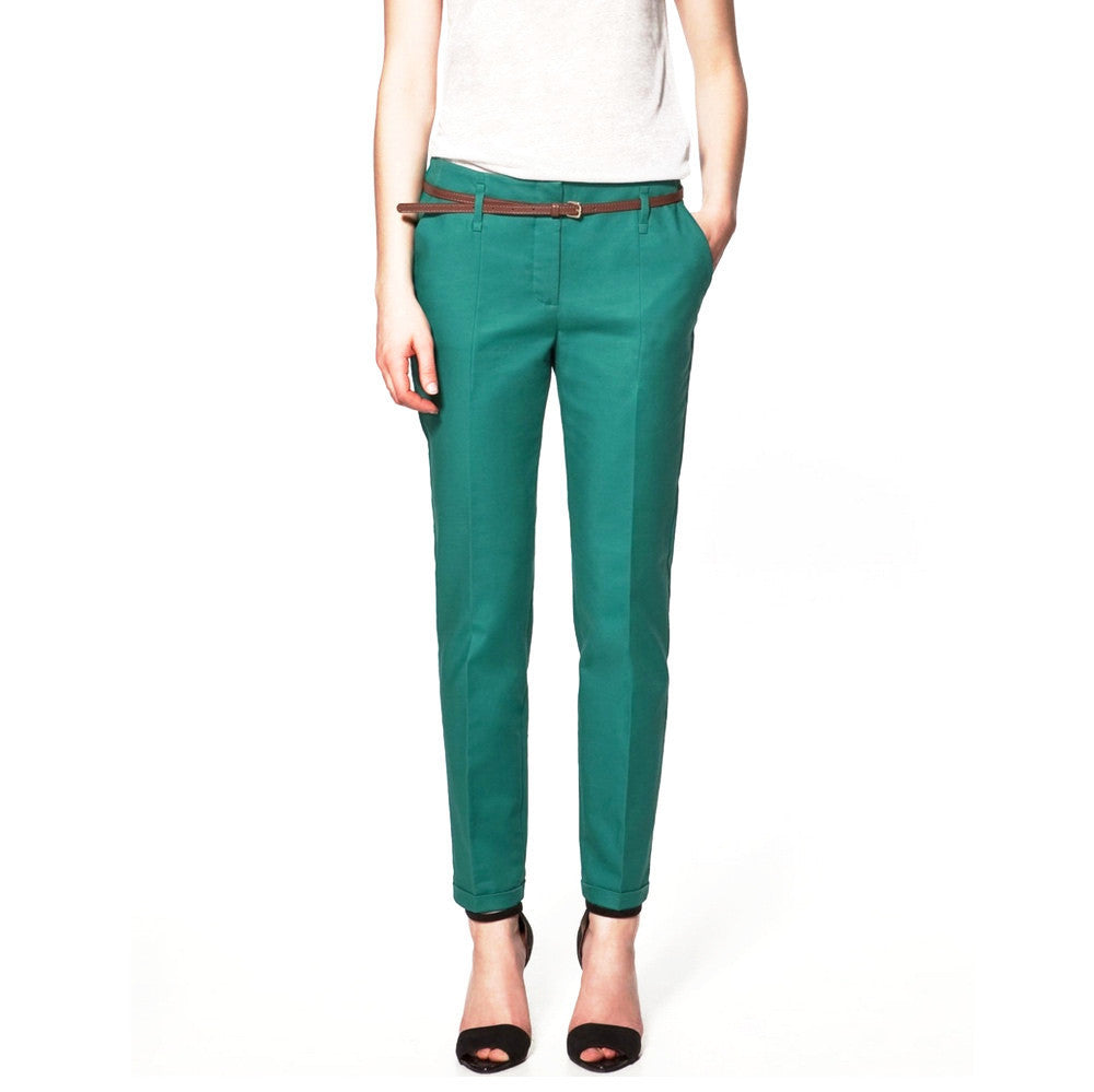 Green pencil pants with belt.