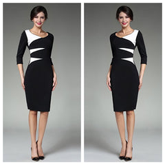 Daring black pencil dress with white abstract print and sleeves.