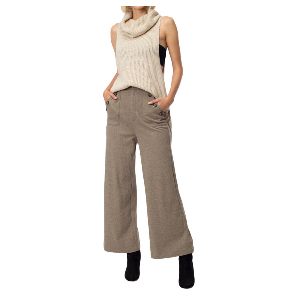 Wide-leg tan sailor-style trousers.