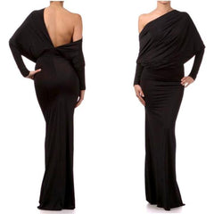 Exquisite off-the-shoulder black dress with flattering ruching, dolman sleeves, and cut-out back.