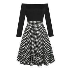 Charming black off-the shoulder fit-and-flare dress with a houndstooth skirt.