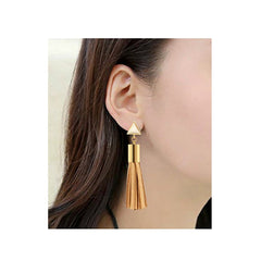 Bisque vegan leather pierced tassel earrings with gold hardware.