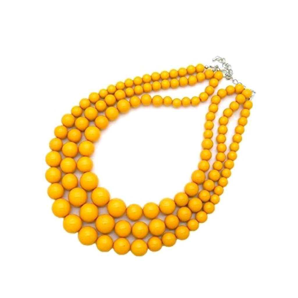 Bold 1960's-inspired yellow multi-strand beaded statement necklace.