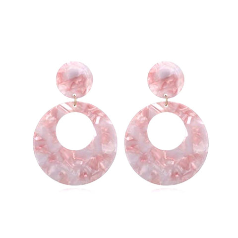 Pink mother-of-pearl statement hoop earrings.