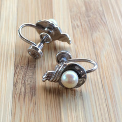 Lovely vintage sterling silver screw back earrings with center glass pearl and diamond-cut etching.