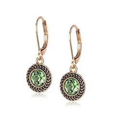 Lovely faceted peridot Swarovski crystal dangle earrings.