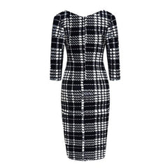 Classic wear-to-work black and white plaid pencil dress with sleeves.