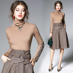Sophisticated two-piece set, including contrast-sleeve turtleneck and a-line skirt.