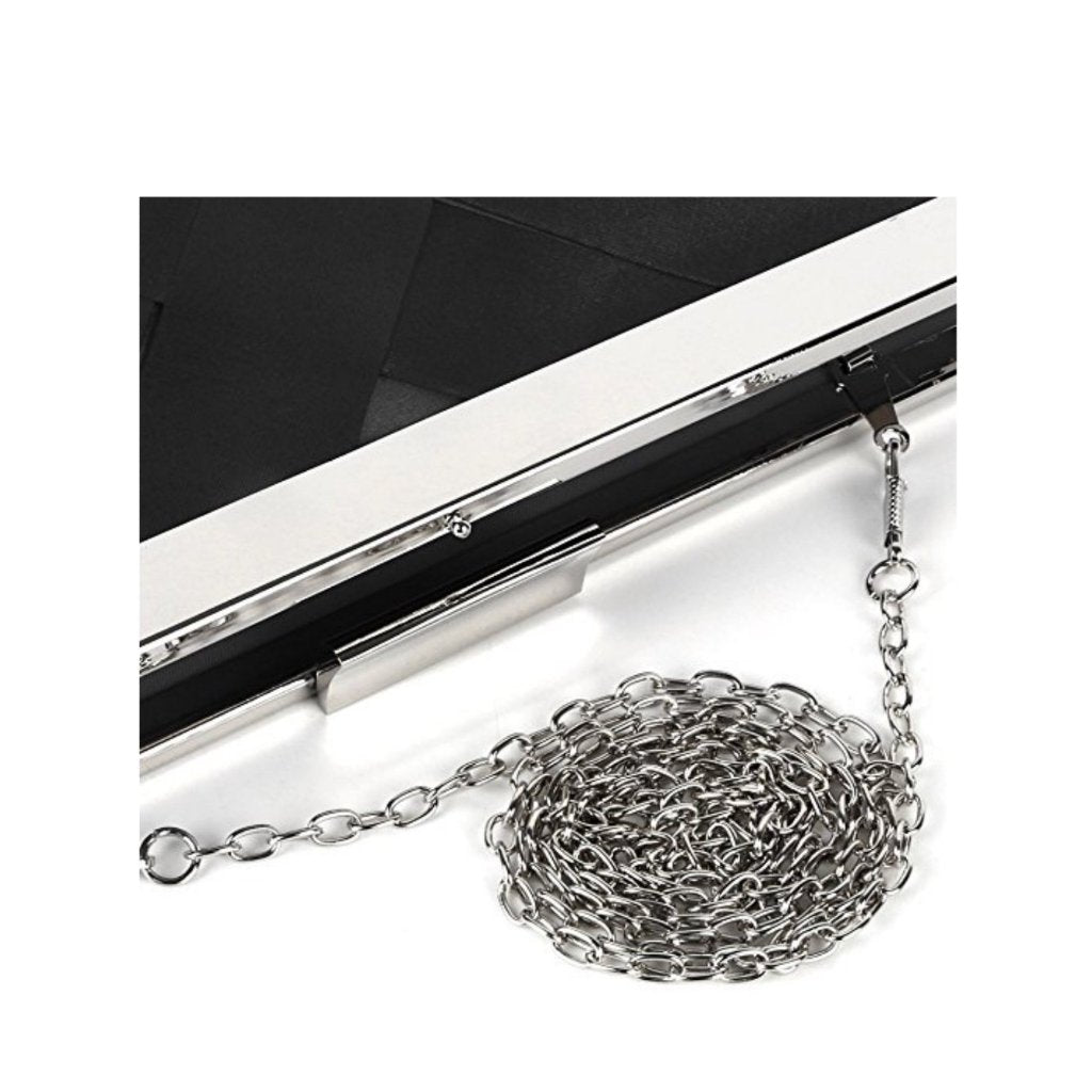 Classic 1950's-style black frame clutch with chain shoulder strap.