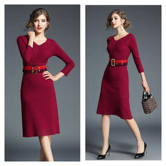 Chic, deep red sweater dress with coordinating belt.