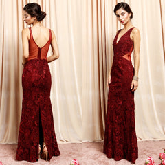 Exquisite deep wine embroidered lace evening gown with gold beaded accents.